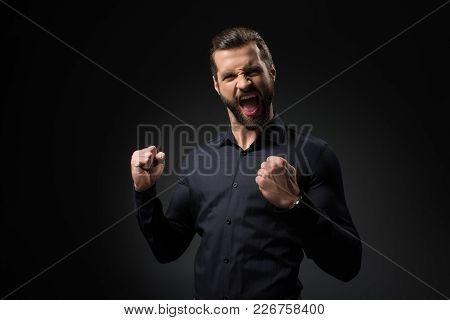 Portrait Of Excited Man Gesturing Isolated On Black