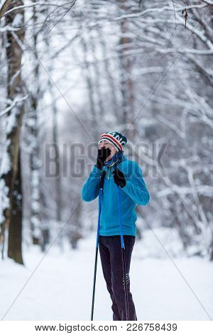 Photo Of Yawning Skier Athlete In Forest At Wintertime