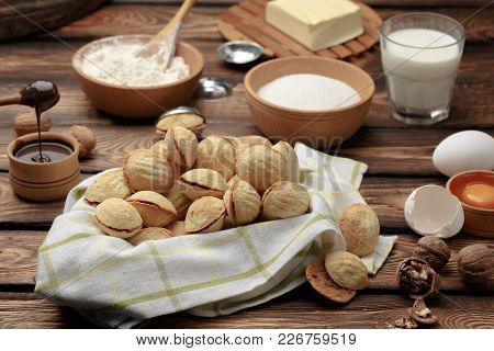 Homemade Cookies Shaped Nuts With Cream Boiled Condensed Milk Against The Background Of The Ingredie