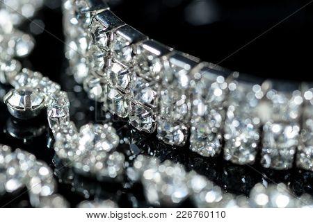 Silver Bracelet And Diamond Necklace Close-up On A Black Background