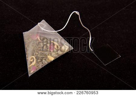 Pyramid Shape Teabag On The Dark Background