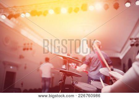 Drums Scene. Close-up Of Plate, Drums, Sticks, In Background Scene Spotlights