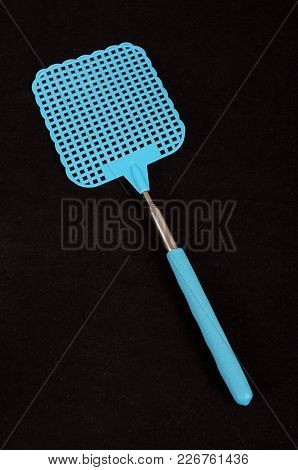 Blue Fly Swatter Isolated On The Black Background