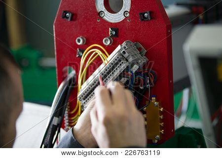 Work Of Electrician Engineer - Switching And Testing Equipment With Wires , Close Up