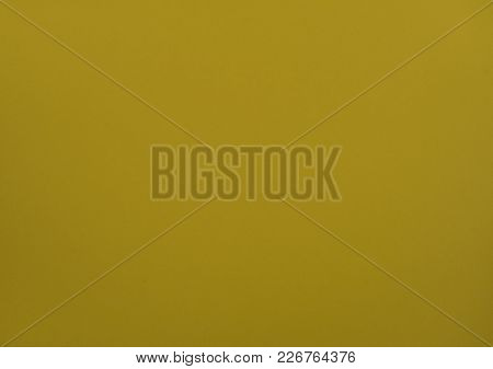 The Natural Dark Yellow Colored Paper Texture Background
