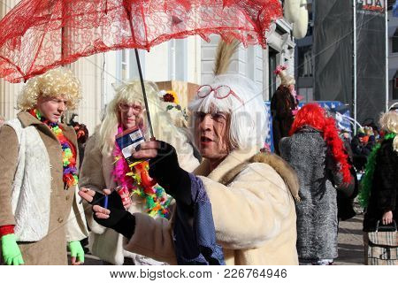 AALST, BELGIUM, 13 FEBRUARY 2018: Unknown costumed carnival participants celebrate during the annual 'Voil Janetten' parade in Aalst. The parade is unique to Aalst and involves a mix of cross dressing and good humoured antics.