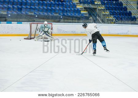 Hockey Game, Professional Hockey Players And Hockey Goalie On Ice