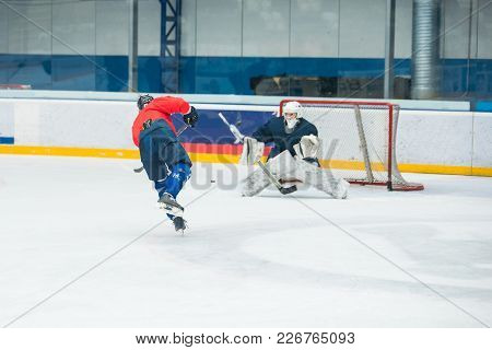 Hockey Player And Goalkeeper On Ice, Training Sport Photo
