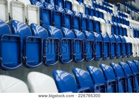 Dark Blue Rows And White Of Seats On The Stadium