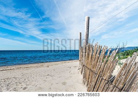 Wooden Palisade On The Sand In Sardinia, Italy
