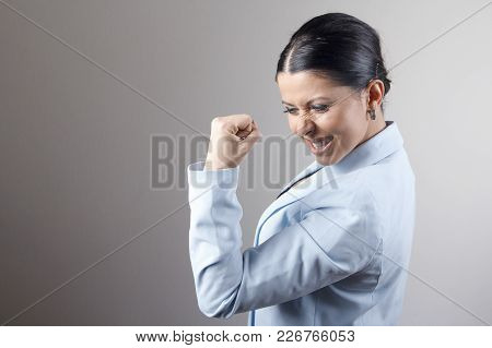 Cheerful Winning Business Woman, Young Lady Celebrating Her Victory, Achievement And Success