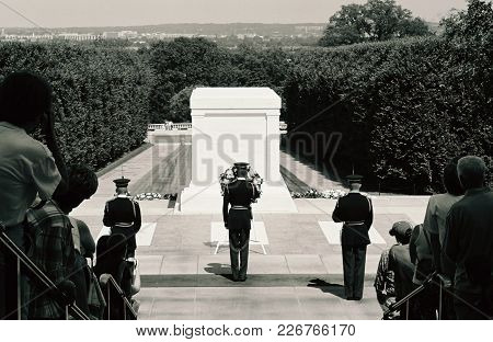 Military Salute During Changing Of The Guard At The Tomb Of The Unknown Solder In Black And White, A