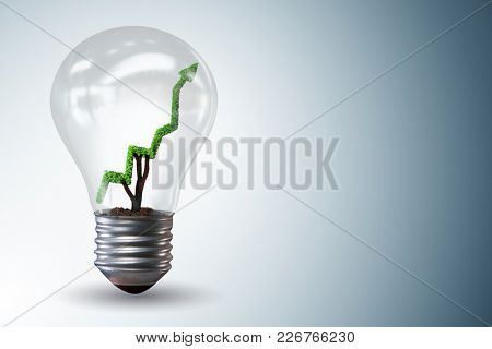 Green energy concept with green line graph in light bulb