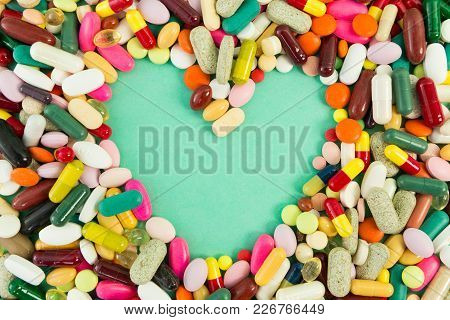 Hearth Shape In The Middle Of Pills Or Tablets