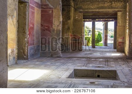 Part Of The Living Room With Frescoes Painted On The Walls In A Ruined House In Pompeii, Naples, Ita