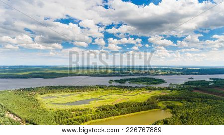 Summer Landscape With Lake And Cloudy Sky. Poland, Europe