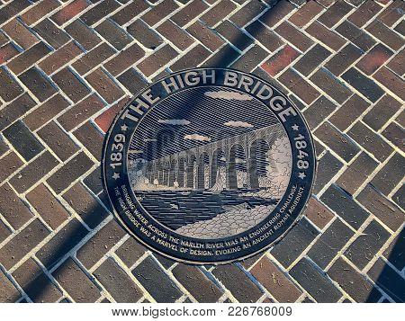 Plaque Denoting The High Bridge (originally The Aqueduct Bridge) Is The Oldest Bridge In New York Ci