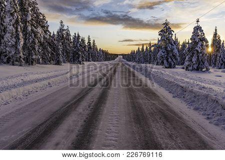 The long empty winter road in Sweden.