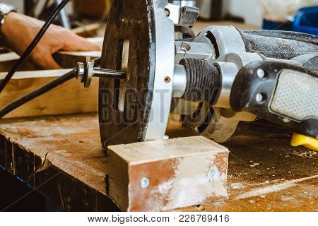 Processing Of A Furniture Part By A Machine For Polishing A Tree. The Grinding Machine On A Board, S