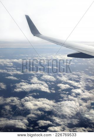 Beautiful Top View From Passenger Supersonic Airplane Window Flying High Above White Clouds In The B