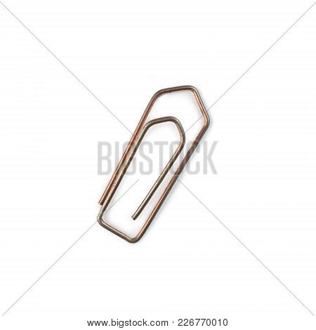 Silver Paper Clip Isolated On White Background. Ideal For Websites And Magazines Layouts
