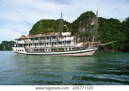 Halong Bay With Tourist Junks And Rocky Islands. Popular Landmark, Famous Destination Of Vietnam