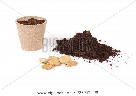 Argiculture Concept: Seeds, Heap Of Soil And Peat Pots