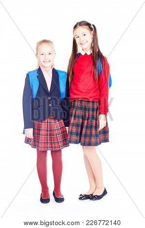 Portrait Of Beautiful Asian And Caucasian Schoolgirls Gossiping On White Background