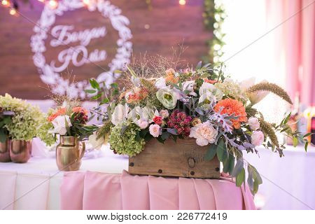 Rustic Flower Arrangement At A Wedding Banquet. Table Set For An Event Party Or Wedding Reception.
