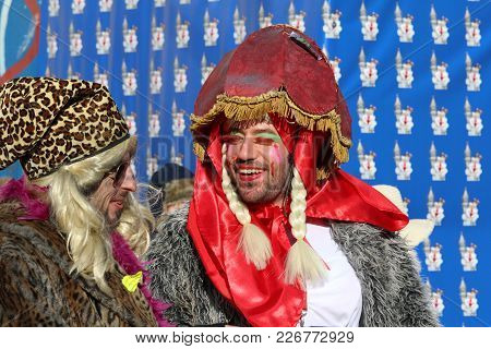 Aalst, Belgium, 13 February 2018: Unknown Costumed Carnival Participants Celebrate During The Annual