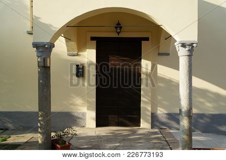 The Entrance Wooden Door In An Old Italian Church.