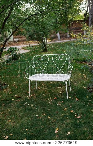 Beautiful White Decorative Bench In The Garden