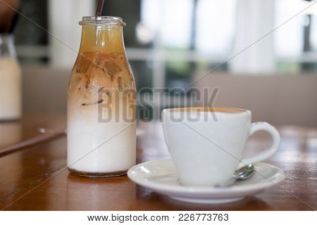 Ice Macchiato Coffee And Hot Coffee On Wooden Tabel