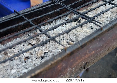 Old Empty Black Grill Grid Ready For Grilling Meat In The Camping Site