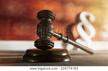 Gavel With Paragraph Symbol In The Background In A Lawyer Office At Day . Ideal For Websites And Mag