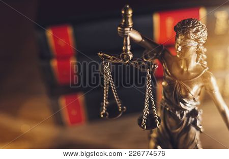 The Statue Of Justice - Lady Justice Or Iustitia / Justitia The Roman Goddess Of Justice In A Court