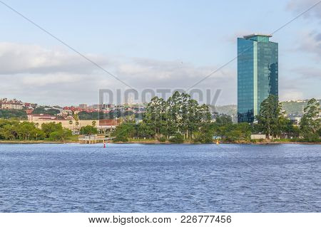 Guaiba Lake Beach With Buildings And Trees
