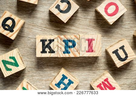 Letter Block In Word Kpi (abbreviation Of Key Performance Indicator) With Another On Wood Background