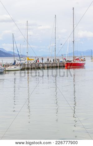 Boats In Beagle Channel With Mountains In Ushuaia