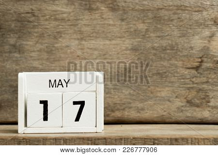 White Block Calendar Present Date 17 And Month May On Wood Background
