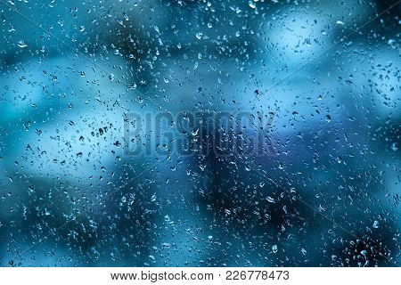 Raindrops On The Windshield Of The Car In The Early Morning. Transparent Glass After Rain, Cold Abst