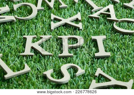 Wood Letter In Word Kpi (abbreviation Of Key Performance Indicator) On Artificial Green Grass With E