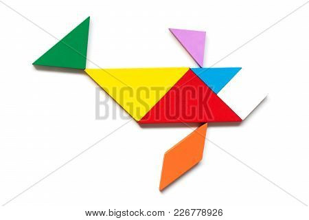 Color Wood Tangram Puzzle In Swimming Fish Shape On White Background