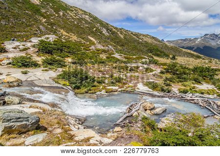 Waterfall In Laguna Esmeralda Trail With  Mountains And Vegetation