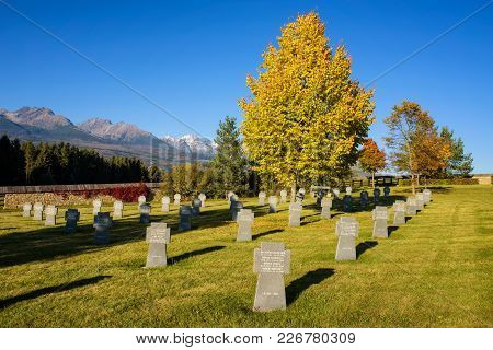 Vazec, Slovaka - October 1, 2017 : German Military Cemetery In Autumn With High Tatra Mountains In T