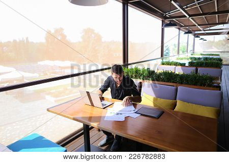Freelance Copywriter Typing Text Fast On Laptop Keyboard At Cafe Table And Looking Tired. Handsome Y