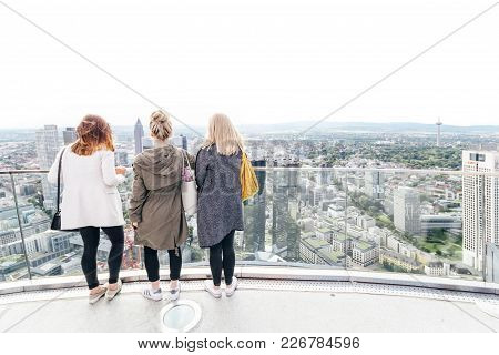 Tourist Girls Enjoying The Beautiful Skyline View On A Sunny Saturday Afternoon From The Top Of Main