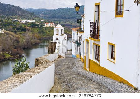 Typical Narrow Street In The Ancient Town Of Mertola, Alentejo Region, Portugal