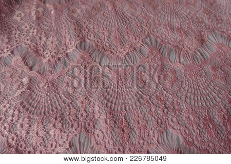 Pastel Pink Perforated Guipure Lace On White Background
