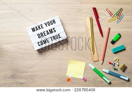 Make Your Dreams Come True Writing In Lightbox With Pen, Pencil, Highlighter And Ruler Lying On Offi